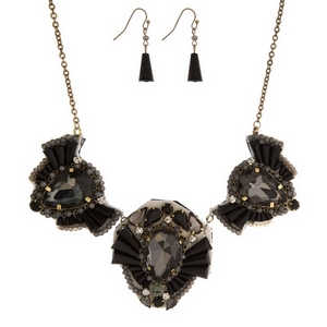 "Gold tone, statement necklace set with three leather-backed, rhinestone clusters. Approximately 16"" in length."