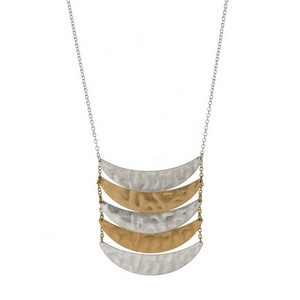 "Long, metal necklace with hammered, curved bar pendants. Approximately 32"" in length."