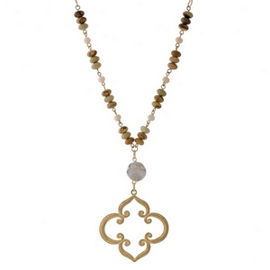 """Gold tone necklace with natural stone beads along the body, a druzy stone and an open clover shaped pendant. Approximately 32"""" in length."""