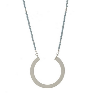 "Silver tone necklace with a half beaded chain and an open circle pendant. Approximately 30"" in length."