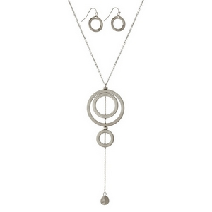 "Burnished metal necklace set with a three part, circle pendant and matching fishhook earrings. Approximately 32"" in length."