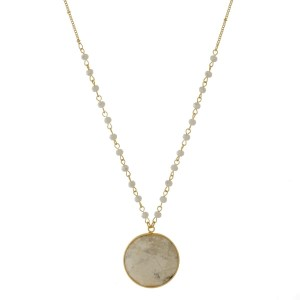 "Gold tone necklace with a faceted, natural stone, circle pendant. Approximately 30"" in length."