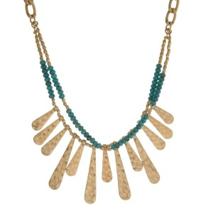"Gold tone statement necklace with natural stone beads and hammered, metal fringe. Approximately 18"" in length."