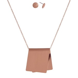 """Dainty metal necklace set with a foldover pendant, matching stud earrings and a matte finish. Approximately 16"""" in length."""