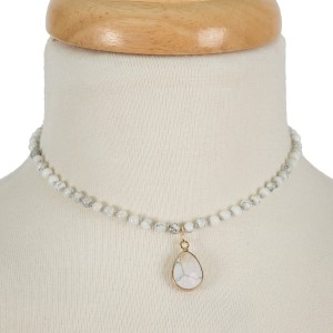"Short, natural stone beaded choker necklace with a teardrop stone pendant. Approximately 12"" in length."