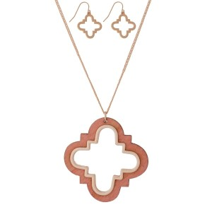 "Long, dainty necklace set with a wooden, quatrefoil shaped pendant and matching stud earrings. Approximately 32"" in length."