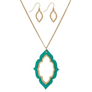 "Long, dainty necklace set with a wooden, moroccan shaped pendant and matching stud earrings. Approximately 32"" in length."