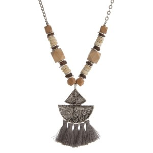 "Metal chain necklace with wooden beads, boho pendant, and soft tassels. Approximately 28"" in length."
