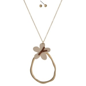 "Long necklace with oval pendant accented with a leather flower. Approximately 34"" in length."