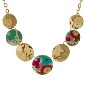 "Short, gold tone necklace with circle pendants covered fabric. Approximately 16"" in length."