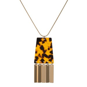 "Gold tone, adjustable necklace with acetate pendant. Approximately 20"" in length."