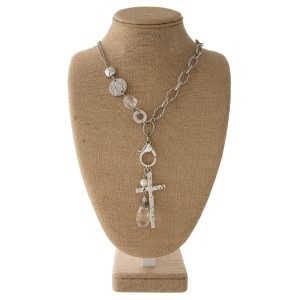 "Short metal necklace with cross and crystal detail. Approximately 18"" in length with a 3"" drop."