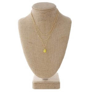 "Gold tone layered necklace with teardrop charm. Approximately 16"" in length."