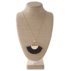 """Long gold tone necklace with faux leather fanned tassel pendant. Approximately 34"""" in length with a 2x4"""" pendant."""