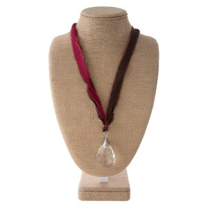"""Fabric cord necklace with crystal pendant. Approximately 22"""" in length."""