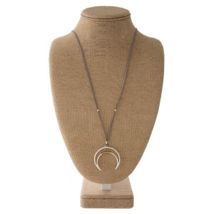 "Long faux leather cord necklace with crescent horn shape pendant. Approximately 32"" in length with a 2"" pendant."