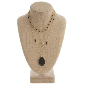 """Layered necklace with filigree pendant. Approximately 16-22"""" in length."""
