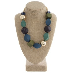 "Short statement necklace with wooden and acrylic beads. Approximately 18"" in length."