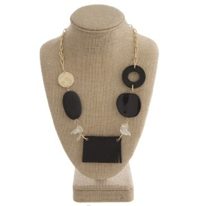 "Gold tone link necklace with wooden beads and faux leather focal. Approximately 22"" in length."