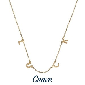 """Short gold tone necklace with charm detail. Approximately 16"""" in length."""