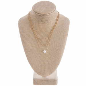 "Multi layered metal necklace with pearl pendant. Approximate 16"" in length with .5"" pendant."