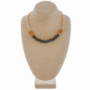 "Long chain linked necklace with curved wood bead details. Approximate 16"" in length."