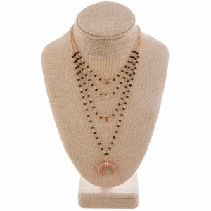 """Gorgeous layered necklace with beaded necklace and horn pendant. Approximate 22"""" in length."""