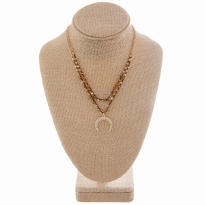 """Gorgeous gold metal and rope necklace with beads and moon pendant. Approximate 20"""" in length with 1"""" pendant."""