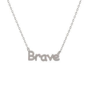 "Metal necklace with small ""Brave"" pendant. Approximate 18"" in length with 1"" pendant."