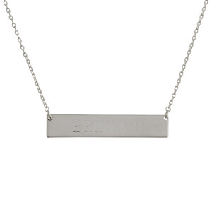 "Gold dipped necklace with bar pendant engraved with message, ""Believe."" Approximate 16"" in length with 1"" pendant."