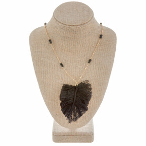 """Long beaded metal necklace with feather pendant. Approximate 38"""" in length."""