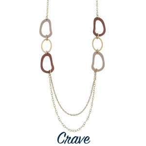 """Multi-color layered necklace with gold tone chain and acetate ring details. Approximately 32"""" long."""
