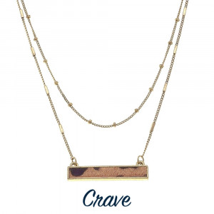 "Gold tone short layered necklace with leopard print bar pendant. Approximately 16"" long."