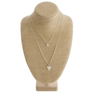 """Long metal necklace with heart pendant. Approximate 22"""" in length."""