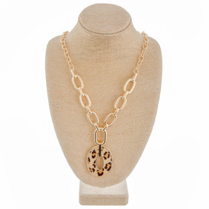 "Long chain linked Y necklace with genuine leather pendant. Approximate 34"" in length."