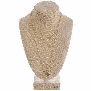 "Long layered necklace with charms and natural stone pendant. Approximate 30"" in length."