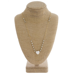 """Long chain necklace featuring square beads and a heart accent. Approximately 31"""" in length."""