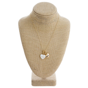 """Long metal necklace with """"Mother"""" and """"I Love You"""" heart pendants. Approximate 18"""" in length."""