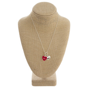 "Long metal necklace with ""Mother"" and ""I Love You"" heart pendants. Approximate 18"" in length."