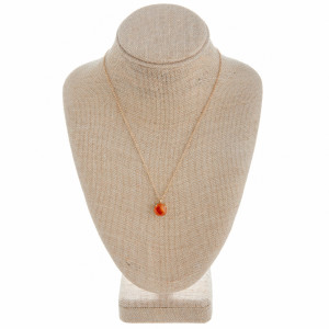 """Long metal necklace with a coral colored natural stone pendant. Pendant approximately 1cm in diameter.  Approximate 21"""" in length."""