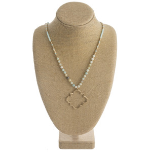 """Long necklace featuring a lotus clover inspired metal pendant with natural stone beaded accents. Pendant approximately 2.5"""" in diameter. Approximately 36"""" in length overall."""