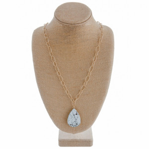 """Long gold chain necklace featuring a teardrop white howlite inspired pendant. Approximately 36"""" in length."""