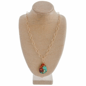 "Long gold chain necklace featuring a teardrop brown and turquoise stone inspired pendant. Approximately 36"" in length."
