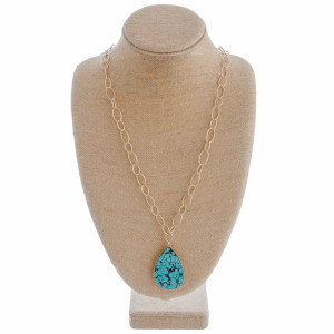 """Long gold chain necklace featuring a teardrop veined turquoise inspired pendant. Approximately 36"""" in length."""