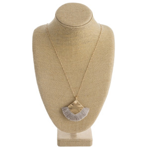 """Long satellite chain necklace featuring a metal plated pendant with tassel accents. Pendant approximately 3"""". Approximately 36"""" in length overall."""