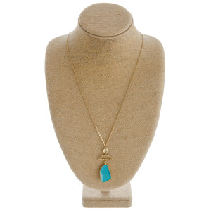 """Long cable chain necklace featuring a natural stone pendant with a gold accent. Pendant approximately 3"""". Approximately 36"""" in length overall."""