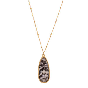 """Dainty satellite chain necklace featuring an iridescent teardrop pendant with zebra print details. Pendant approximately 1.5"""". Approximately 20"""" in length overall."""