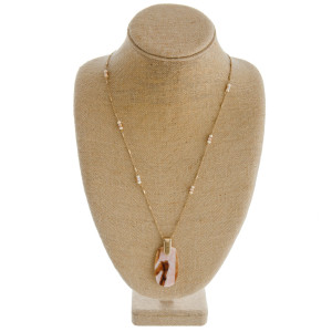 """Long link bar chain necklace featuring a resin marble pendant with faceted and wood beaded details. Pendant approximately 2.5"""". Approximately 38"""" in length overall."""