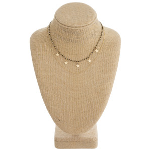 """Dainty layered seed beaded necklace with star accents. Approximately 16"""" in length."""