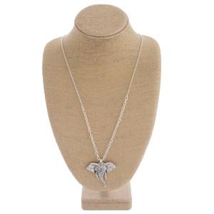 """Long metal elephant pendant necklace. Pendant approximately 2.5"""" in length. Approximately 36"""" in length overall."""